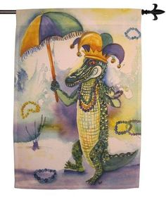 ThisMardi Grasthemed decorative house flag features a fun twist. Agrinning gator is all decked out in Mardi Gras beads, jester hat andholding a purple, green and gold umbrella. Have some laughs ar