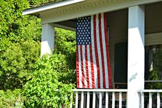Flag on Front Porch - I want these porch columns too