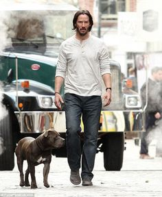 In character: It appeared Keanu Reeves was simply out for a leisurely walk with his pit bull around New York City on Thursday, though he was actually filming new scenes for John Wick 2