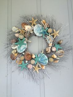 Beautiful Coastal Wreath. I especially like the turquoise-blue dry-brushed shells and turquoise starfish. Very inspirational. Well done artistry!