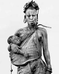 A woman and child from the Murzi (or murzu) tribe.