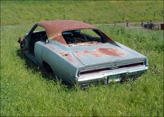 Someone please take this 1969 Charger back to life. Junkyard Cars, Wrecking Yards, Dodge Charger Daytona, Car Barn, Good Looking Cars, Dodge Chargers, Abandoned Cars, Depressing, Barn Finds