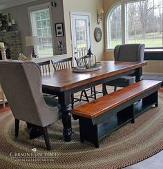 """Upholstered end chairs complement the hefty, substantial look of this reclaimed barn wood table, with matching bench. 5"""" turned legs add some soft curves to the dining set. Custom handcrafted using reclaimed barn wood, in the heart of Amish country, Lancaster County, Pennsylvania - www.braunfarmtables.com"""