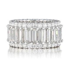 WOW what a gorgeous eternity band…I think 13 years of marriage calls for this….my right hand needs some love-bling…=)