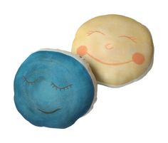 """We love this new double sided mini pillow. This is a hand painted water color image printed with eco friendly water based inks on the softest 100% USA organic cotton jersey fabric. One side is a happy sun, and on the reserve side a sleepy moon, stuffed with poly-fil. They measure about 8"""" wide, and 7"""" tall. These are the perfect little lovey for your tiny one."""