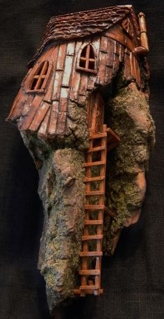 Cottonwood Bark Gnome House with long ladder to entrance. Carved by N. Minske.