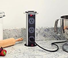 Hidden Pop-up Outlet. Good kitchen idea.