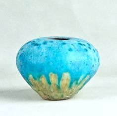"HAND-BUILT MINIATURE SQUAT BODY VASE or POT WITH TURQUOISE DRIP GLAZE, 2017  (Free Shipping to the Lower 48 States Only)    Here is a very nice hand-built MINIATURE SQUAT BODY STONEWARE VASE/POT by California ceramicist David Farnsworth. It is from his current series of hand built miniature pottery vessels. This round bellied vessel is 3"" in height and slightly over 4"" at it's widest point before it tapers down to the 1.25"" diameter base. It has a light turquoise colored glaze on a slightly…"
