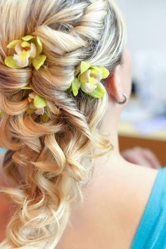 Long curly bridesmaid hairstyles with orchid flowers | Wedding Wishes Wedding Guide