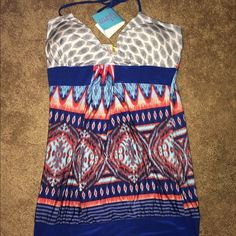 Dress never worn! New with tag! Short dress, never worn and still has tag! It is a size large however I think it's juniors... It fits much smaller more like a small/medium. Has thin straps that tie around your neck. Dresses
