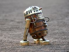 """This steampunk R2-D2 has been lovingly made out of wood and brass. Although the astromech droid is now too small to fit an actor, he's got some nice dials and knobs. It was created by the artist Amoeblablok who says that he won't be selling off this steampunk droid on eBay, but he wants to find a home for it. The steampunk droid needs someone who will love it and care of it."""