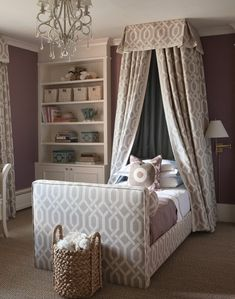 Sophisticated Girl's Bedroom A pretty chandelier, built-in bookcase and mauve walls add richness. A departure from more standard little girl colours and details, this bedroom is outfitted with a tailored canopy bed upholstered in a print sophistic Grey Girls Rooms, Teen Girl Bedrooms, Little Girl Rooms, Sophisticated Girls Room, Home Bedroom, Bedroom Decor, Glam Bedroom, Pretty Bedroom, Design Bedroom