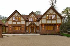 Traditional house design looking cosy with warm lights and Oak detailing.