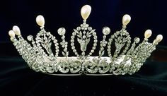 A beautiful and delicate belle epoque tiara from the Spanish jewellers, Ansorena, circa 1890. Designed as nine foliate motifs, surrounded by diamonds, and topped by pear-shaped natural pearls, with diamond spacers, intertwined at the base by diamond scrolls and bows, resting on a band of platinum.