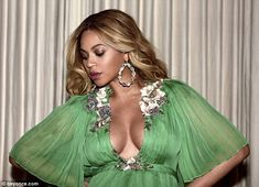Eye popping cleavage: Beyonce displayed an ample amount of cleavage in her green gown...