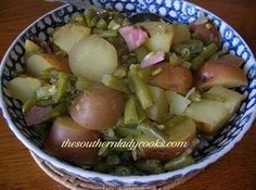 Green Beans and Potatoes: 2 pounds green beans, 6 or 7 potatoes cut in pieces, couple teaspoons bacon drippings, 1 to 2  cups chicken broth, 1 ham hock, 2 to 3 cups water, 1/2 teaspoon black pepper, 1 teaspoon salt, 1/2 cup finely diced onion, 1 teaspoon minced garlic