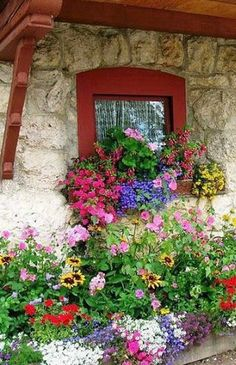 Cottage window box bouquet... would love to know the location.... because of some kind of extended wood overhang i am going to guess in Switz or Italy.....