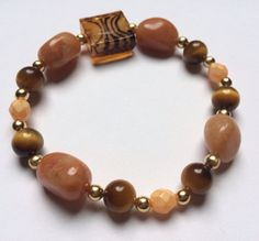 Brown Orange and Gold Beaded Bracelet by UniqueDesignsByKait, $13.00