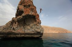 Cliff diving from Lima Rock....one of many adventure activities at Six Senses Zighy Bay.  www.sixsenses.com/sixsenseszighybay