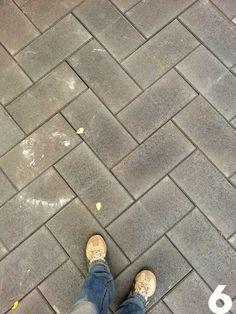DIY concrete paver patio in herringbone pattern. From Laura's Backyard Renovation