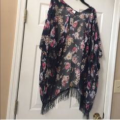 Floral Kimono BNWT! This kimono is beautiful! Lightweight and flowy!! The perfect piece for spring and summer! It is a little hard to see in the pictures but this piece is a beautiful navy blue Sweaters Cardigans