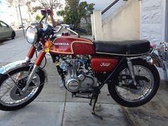 My freshly restored bike is getting a final tuneup as we speak. 1972 Matador red (metal flake paint!) Honda CB350 four