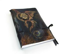 Mystic Dragon - Black Leather Journal - Leather Art Journal with Lined Paper. $58.00, via Etsy.
