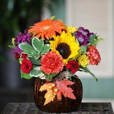 Here comes the pumpkins!  We love Fall arrangements. :)