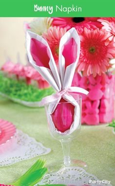 An adorable idea for your Easter brunch to create this darling place setting. Take a small plastic wine glass, fill it with a dinner napkin wrapped Easter egg and tie a ribbon at the top to make the ears. Watch the smiles spread