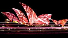 Vivid Festival projections on the sails of Sydney Opera House. Best places to eat and drink