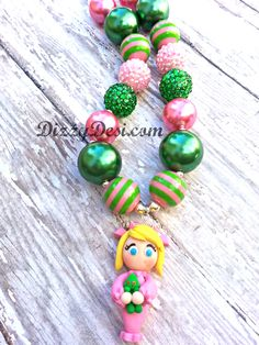 Cindy Lou Who, holding her grinch doll!  Available at facebook.com/dizzydesidiamonds