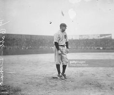 Informal full-length portrait of Hall of Fame baseball player Ty Cobb (1886 - 1961) of the American League's Detroit Tigers baseball team, smiling while standing on third base on the field at South Side Park, located at West 37th Street, South Princeton Avenue, West Pershing Road (formerly West 39th Street), and South Wentworth Avenue in the Armour Square community area of Chicago, Illinois, 1908. From the Chicago Daily News collection.