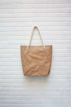 Kraftpaper fabric bag in Natural with cotton strap by Womensgirl, $36.00