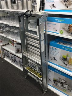 When your merchandise reaches skyward almost to the industrial-height ceiling, you need Step Ladder support in retail. Should it be left in the aisle for unsupervised use by shoppers I leave to you. Bungee Cord, Ladder, Locker Storage, Industrial, Retail, Ceiling, Simple, Stairs, Ceilings