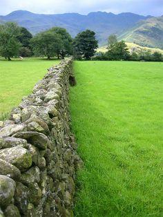 Lake District field...would like to walk along beside this beautiful stone wall.!