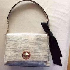 Kate Spade purse with bow Gorgeous Kate Spade purse that goes with everything! Comes with original Kate Spade dustbag! Great condition, just a few marks on the inside lining (refer to last photo) kate spade Bags