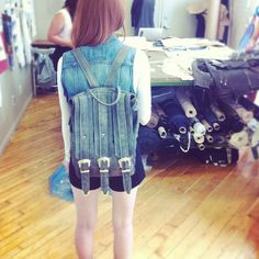 A happy customer picking up her Triple Strap Backpack