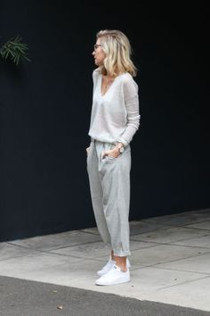 Love the V neck of the shirt with this gray trouser.