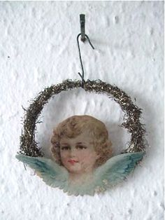 Victorian Christmas tinsel decoration with glass ornament and angel scrap Christmas Tinsel, Antique Christmas Ornaments, Vintage Ornaments, Christmas Angels, Christmas Tree Ornaments, Christmas Villages, Vintage Santas, Christmas Christmas, Victorian Christmas Decorations
