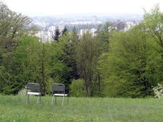 Moveable chairs from the Basel Stadtgärtnerei at the parklike Hörnli Friedhof in Basel, Switzerland.
