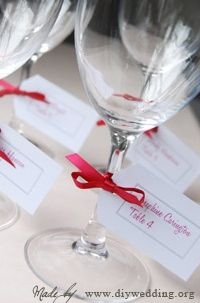 Wedding Escort Cards attached to wine glasses. Get the guests drinking right off top! lol