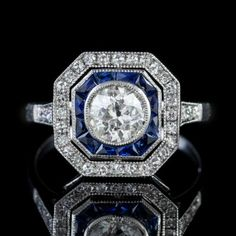 This extravagant all White Gold cluster ring is crowned with a stunning old European cut Diamond at its heart with borders of French cut Sapphires and single cut Diamonds. Art Deco Diamond Rings, Antique Diamond Rings, Ruby Diamond Rings, Diamond Art, Art Deco Ring, Diamond Cluster Ring, Antique Engagement Rings, Vintage Diamond, White Gold Eternity Rings