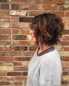 I think this is a cute hairstyle for short curly hair.