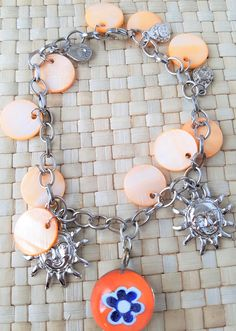 Handmade bracelet in orange with metal suns and orange, blue and white flower pendant by Ebooksandhandmade on Etsy Flower Pendant, Handmade Bracelets, White Flowers, Blue And White, Orange, Metal, Accessories, Jewelry, Jewellery Making