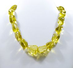 Lemon Quartz Beads in Strand and Jewelry. View beautiful designs and all details about beads at ExploreBeads. You can also customize your order.