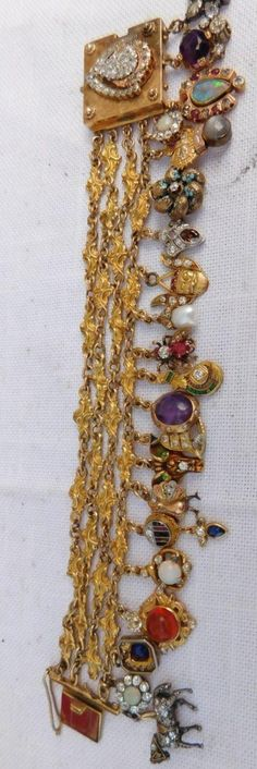 Magnificent 14k gold victorian 21 diamond covered charms bracelet one of a kind
