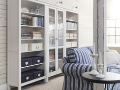 HEMNES bookcases are solid wood, with four adjustable shelves and one stationary shelf for high stability. The  bottom shelf is removable, so you can hide multiple power strips, etc underneath. Designer: Carina Bengs