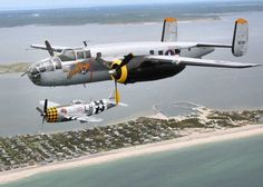 """To mark the 70th anniversary of the end of the World War II, a B-25 bomber, foreground, and a P-47 Thunderbolt fighter made a 'Tribute Flight"""" over the south shore of Long Island on Thursday, May 21, 2015. These two legendary World War II era planes will join other vintage aircraft in this weekend's Bethpage Airshow at Jones Beach. (Credit: Newsday/ John Paraskevas)"""