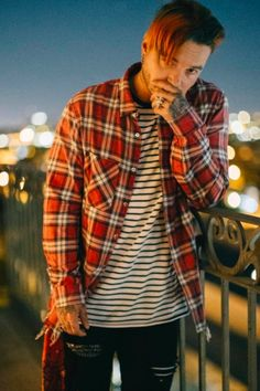 J Balvin wearing  Amiri Plaid shirt, Amiri Striped T-Shirt, Amiri Art Patch Jean