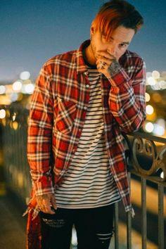 J Balvin wearing  Amiri Plaid shirt, Amiri Striped T-Shirt, Amiri Art Patch Jean